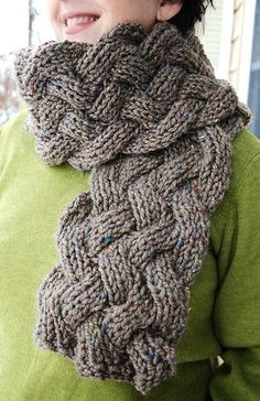 Free pattern for a reversible cabled chunky scarf. The entire scarf is knit in a K1P1rib, with cables. Noro yarn