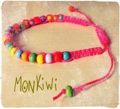 Bracelet en perles de rocailles couleurs fluo et acidulés...