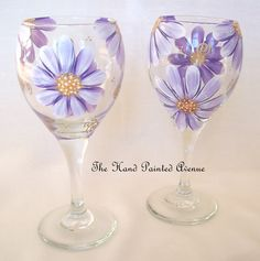 ***** Whimsical Purple Daisies ******   This one hand painted wine glass feature whimsical purple daises with orange & brown centres with