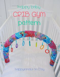 Crib Gym DIY (basically a covered pool noodle with tags for toys to hang from) for early morning play