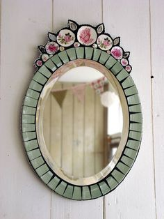 love this vintage crockery mirror by Anna Tilson