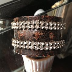 Distressed leather cuff with vintage rhinestones