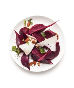 Beet and Ricotta Salata Salad: Top roasted beet wedges with chopped fresh mint, almonds, red wine vinegar, and ricotta salata shavings—a salty, crumbly cheese with a mildly nutty flavor. Finish the delicious side dish (or light lunch) with a drizzle of olive oil. Use Feta or goat cheese, if you can't find ricotta salata at your local supermarket.