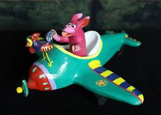 Dog & Rooster go flying in a plane! Playful Mexican folk art by Ortega Family   #HandMade