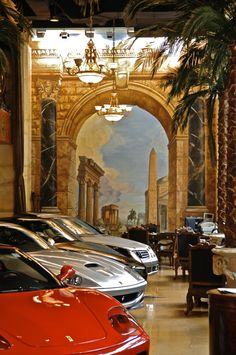 Simes Studios, Inc. Arch and columns with panoramic view of Roman antiquity, painted on canvas. Bentley showroom.