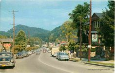 Sixty years ago in Gatlinburg, Tennessee . . .   A Street Scene in Gatlinburg, Tennessee. Names on buildings that can be read are: The Cliff Dwellers Shop; Edgepark Motel; Whittle Drugs; Pan Am. This postcard view is from the 1950's