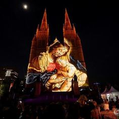 A Christmas-themed projection featuring Mary and baby Jesus illuminates the facade of Sydney's St Mary's Cathedral on the opening night of the Catholic church's celebration of the Christmas season in Australia, December 8, 2016. REUTERS/Jason Reed @jasefoto #reuters #reutersphotos #australia #sydney #christmas #church #lights
