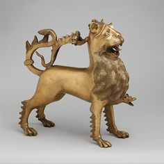 Aquamanile in the Form of a Lion Date: ca. 1400 Geography: Made in Nuremberg Culture: German Medium: Copper alloy Dimensions: Overall: 13 1/8 x 13 3/8 x 4 3/4 in., 11.764lb. (33.3 x 34 x 12.1 cm, 5336g) Overall PD: 12 9/16 x 4 5/8 x 12 1/2 in. (31.9 x 11.8 x 31.8 cm) Thickness PD: 3/50-7/50 in. (0.16-0.35 cm) Classification: Metalwork-Copper alloy