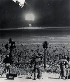 Photographers record blast from air-dropped atomic bomb at Yucca Flats, Nevada.  March 31, 1953
