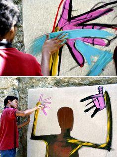 Jean-Michel Basquiat, himself, working on a piece