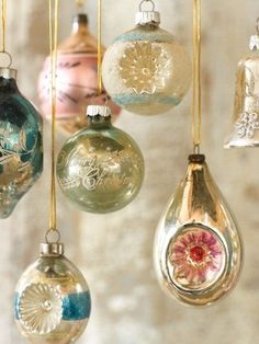 Vintage Holiday Ornaments hung by beautiful ribbon...easy to create with your collection or mix new and old ornaments for a beautiful hanging display