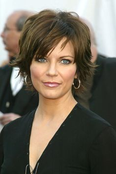 MARTINA MCBRIDE -- love her!! Also shares the same first name as my mother :)