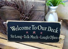 "This handmade Wood sign is is great for your outdoor deck decorating...It's made from pine, and measures Approx 5.5""W x 13""L. It reads ""Welcome to Our Deck"". The front is painted black then distressed"