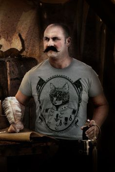 I love that this guy looks like he is ready to fight someone while wearing a cat shirt. Gen. Scooter Foxy McGee Gents by MaidenVoyageClothing on Etsy, $28.00