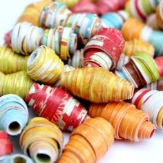 Full color tutorial showing how to make different shaped paper beads.