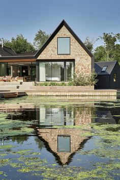 This house in the Norfolk Broads by Platform 5 Architects features steeply pitched gables and shingle cladding to reference traditional boat sheds.