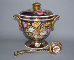 Spode tureen, cover and ladle painted with bouquets and sprays of flowers on a blue and gold scale pattern ground with beaded rim and base. Thirteen inches high and marked SPODE 1166 in red enamel. From the collection of the Earl of Lincoln, Christies June 1937; formerly in the collection of the 7th Duke of Newcastle at Clumber, Worksop, Nottinghamshire. Exhibited at Nottingham Castle Museum.