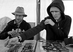 This last Sunday three Seattle Pacific University students came by Tent City 3 to just hangout and spend time in camp, getting to know the residents. What a beautiful example of just reaching out and saying hello. Thank you students of SPU!  Tony, on the left, is a resident of Tent City 3 and is being schooled by two of the visitors on a card game. Meanwhile, the third student was getting whooped in a game of chess by one of the other campers.  Queen Anne 2/8/2012