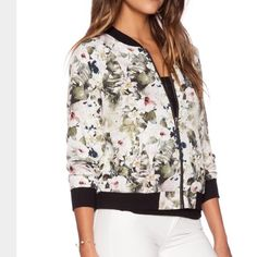 Sanctuary Bomber Jacket Cute floral print jacket by Sanctuary. Zipper in the front as well as one zippered pocket on the sleeve. Sanctuary Jackets & Coats