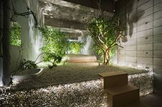 Room 302: Buried by Yuko Nagayama Wooden elements and furniture are buried in white pebbles. This makes the space change instantly as if snow falls in a city landscape; gaps in time and material link up naturally.