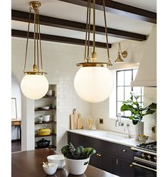 Farmhouse Lighting Design Tips Now is the perfect to start thinking about redecorating your farm home's interior. Farmhouse Lighting, Kitchen Lighting, Art Deco Lighting, Lighting Design, Lighting Ideas, Unique Wall Decor, New Kitchen, Kitchen Ideas, Brass Kitchen