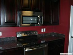 Dark Cabinets with red walls