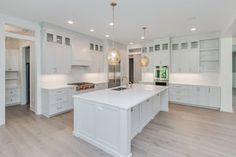 9 23 16_BS-06-136_Kitchen_White cabinetry_hardwood-min.JPG