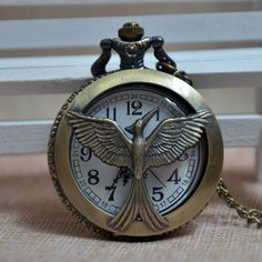 Best price on Punk Hollow Hunger Games Bird logo Bronze Quartz Pocket Watch Pendant Necklace Chain Mens Womens Gift P016 //   See details here: http://alichronoworld.com/products/punk-hollow-hunger-games-bird-logo-bronze-quartz-pocket-watch-pendant-necklace-chain-mens-womens-gift-p016/ //  Truly a bargain for the inexpensive Punk Hollow Hunger Games Bird logo Bronze Quartz Pocket Watch Pendant Necklace Chain Mens Womens Gift P016 //  Check out at this low cost item, read buyers' comments on…