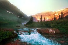 The bubbling waters of the Belly River with sun shining on the mountains - glacier park, montana