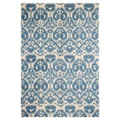 Anchor your living room seating group or define space in the den with this eye-catching wool rug, featuring an ikat motif in beige and blue....