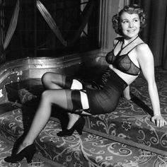vintage lingerie-- you know what's so interesting about this?  Her ensemble is sexy as all get out, but she is modestly covered, and she looks as sweet and innocent as apple pie