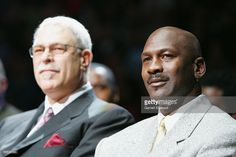 Phil Jackson and Michael Jordan watch the ceremony retiring the #33 jersey of Scottie Pippen during the Chicago Bulls game the Los Angeles Lakers on December 9, 2005 at the United Center in Chicago, Illinois. The Lakers 93-80.