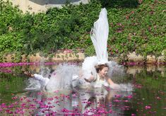 Thai groom Sopon Sapaotong (L), and his bride Chutima Imsuntear, jump in a pond during a wedding ceremony Strange Photos, Photos Of The Week, Outdoor Furniture, Outdoor Decor, Fun Activities, Cool Photos, Amazing Photos, Pond, Wedding Ceremony