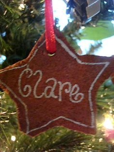 Cinnamon ornaments - Making It Feel Like Home - Mix 1 cup cinnamon, 1 cup applesauce, 1 tbsp glue.  Put between 2 sheets of plastic, roll out to 1/4 to 1/3 inch, cut shapes, poke hole for ribbon.  Bake at 200 for about 2 hrs then let dry for 8 hrs.  Decorate if desired.  DO NOT EAT!
