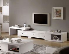 modern-living-room-decor-be-equipped-white-tv-stand-and-modern-coffee-table-or-white-coffee-table-plus-living-room-carpet-and-wood-flooring-living-room.jpg 700×541 pixelov