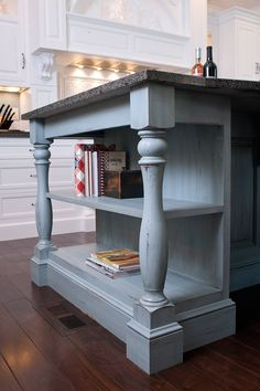 Cookbook bookshelf on island with massive, turned corner post legs. Love these legs and the way the skirting is done. Possible idea for revamping kitchen island.