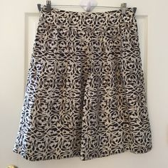 "Skirt.   ( NEW LOWER PRICE ) Great condition, like new. 24"" long with zipper in back and is fully lined. Dark brown Banana Republic Skirts Circle & Skater"