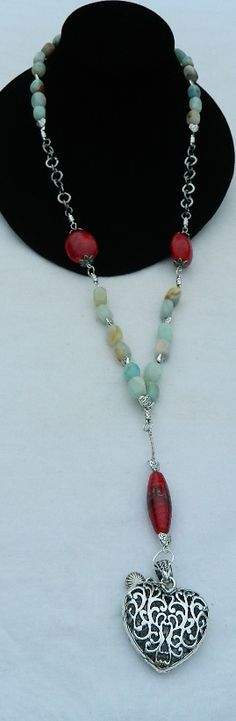 "Fluorite stones Tibet silver With red focal beads, drop necklace. Gun medal chain divides the necklace. & heart drops..5"" necklace measures 27 1/2"" long & heart is 1 1/2"""