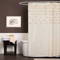 """Ivory shower curtain with handmade floral accents.   Product: Shower curtainConstruction Material: 100% PolyesterColor: IvoryFeatures:  Decorated with handmade flowersSophisticated and romantic Dimensions: 72"""" H x 72"""" WCleaning and Care: Machine wash and lightly iron if needed. Dry cleaning recommended."""