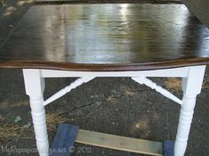 repurposed kitchen table.  I love the white legs and dark top
