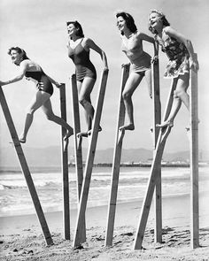 Stilt walking on the sand in England, in the 1940s. Via Beside the vintage seaside.