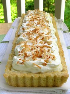 Coconut Cream Tart. Tarts are like pies only they like to keep their tops off and their walls down. Ok, enough of the innuendo, I was looking for a coconut cream thing for those times when I want to play old fashioned church social and here it is.
