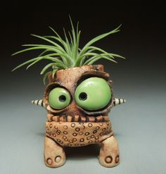 I really like these whimsical ceramic creatures by James DeRosso. Yes, they have bulging eyes and toothy grins, but they're not scary at all.