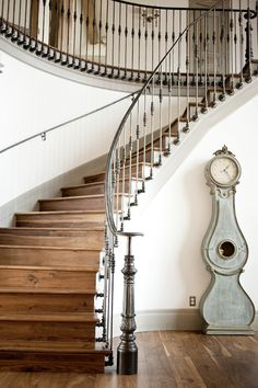 Sublime Cuckoo Clock decorating ideas for Attractive Staircase Traditional design ideas with clock curved staircase grandfather clock gray baseboard handrail railing staircase railing stairs