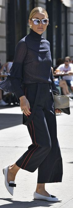 Who made Olivia Palermo's white sunglasses, black dot tiered sleeve top, white bow flat loafers, and tan zipper clutch handbag?