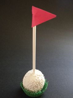 "Golf ball cake pop trial run.  I used small silicone cupcake molds to make the ""grass""."