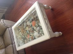 White Coffee table that I added a bottom to and filled with sea shells :)