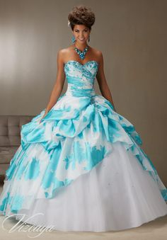 Quinceanera dresses by Vizcaya Printed Organza Ruched Skirt Over Tulle with Beading Matching Bolero Jacket included.Colors: White/Turquoise, White/Lilac.