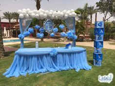 Candy Table With Pompoms and Cloud Balloons for Baby Boy Blue and Silver Themed Baby Shower Decorations by Leila Events (01169). For orders or further info call or whatsapp +201222220889