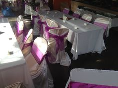 The universal chair cover in off white satin fabric with purple organza bow!    BOOK YOUR CHAIR COVER RENTALS TODAY!💙💙 Chair Cover Rentals, White Satin, Satin Fabric, Bow, Table Decorations, Purple, Furniture, Home Decor, Arch